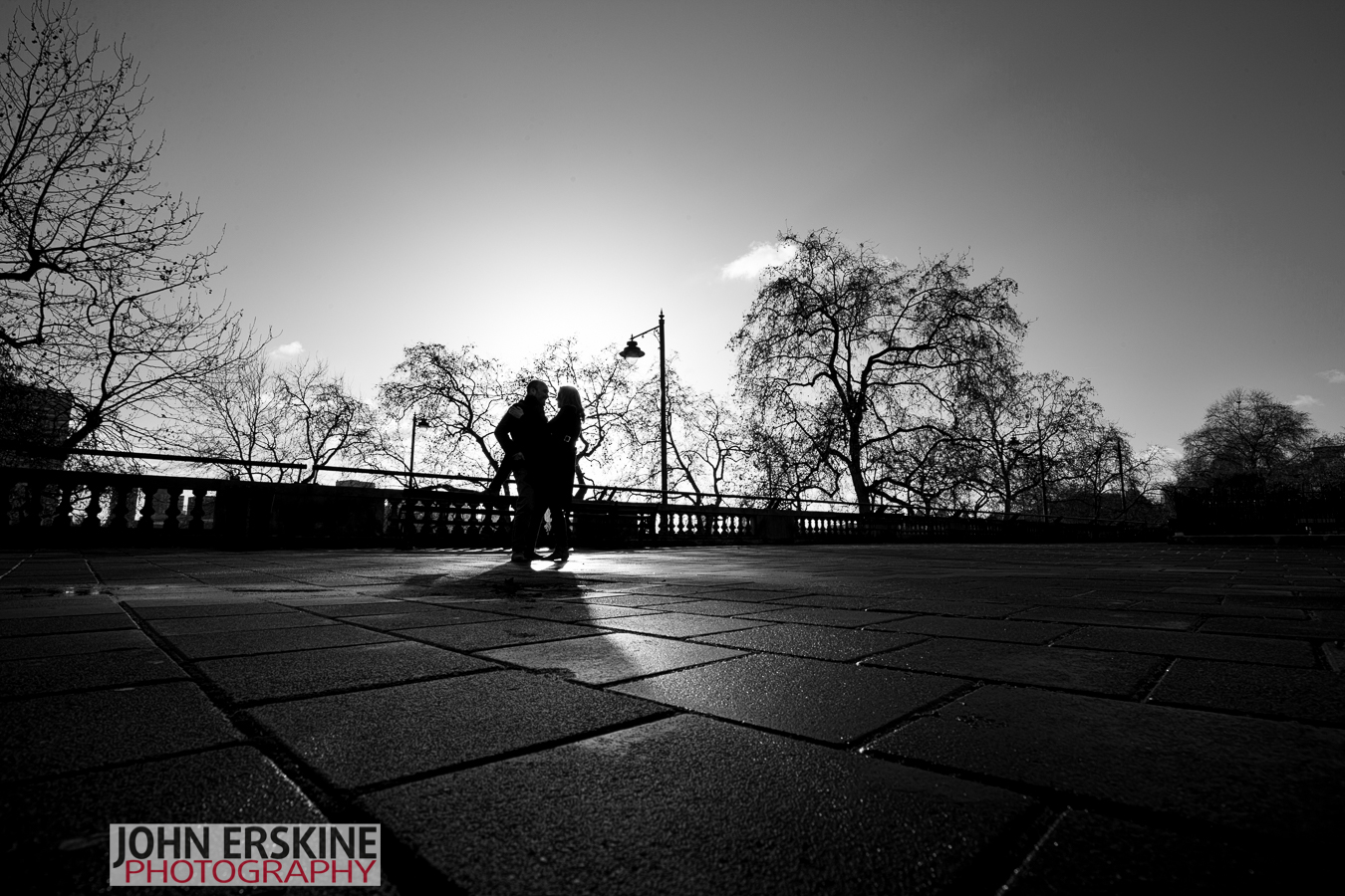 black and white silhouette fun in winter sun - Engagement Photography