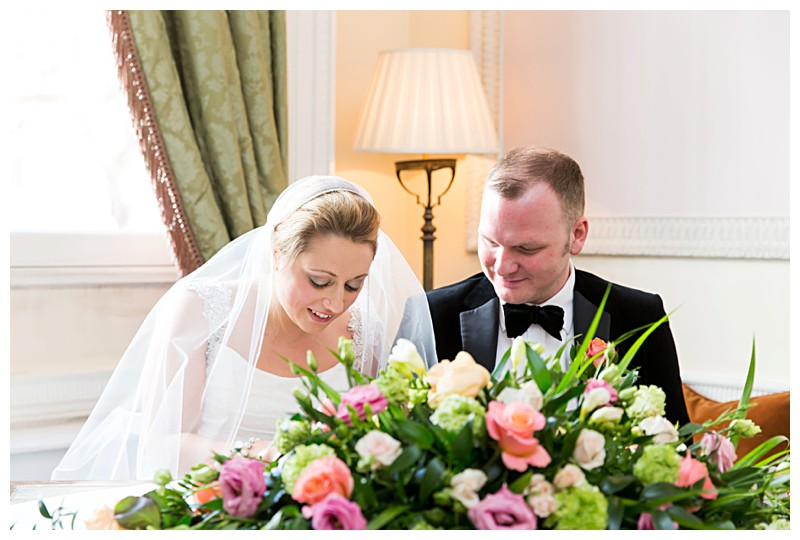 Best London Wedding Photographer Lansdowne Club Signing the Register