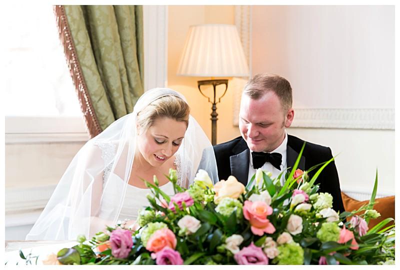 Best London Wedding Photographer Lansdowne Club Signing the Register