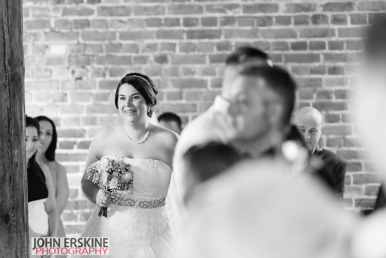 A brides happy tears in the aisle