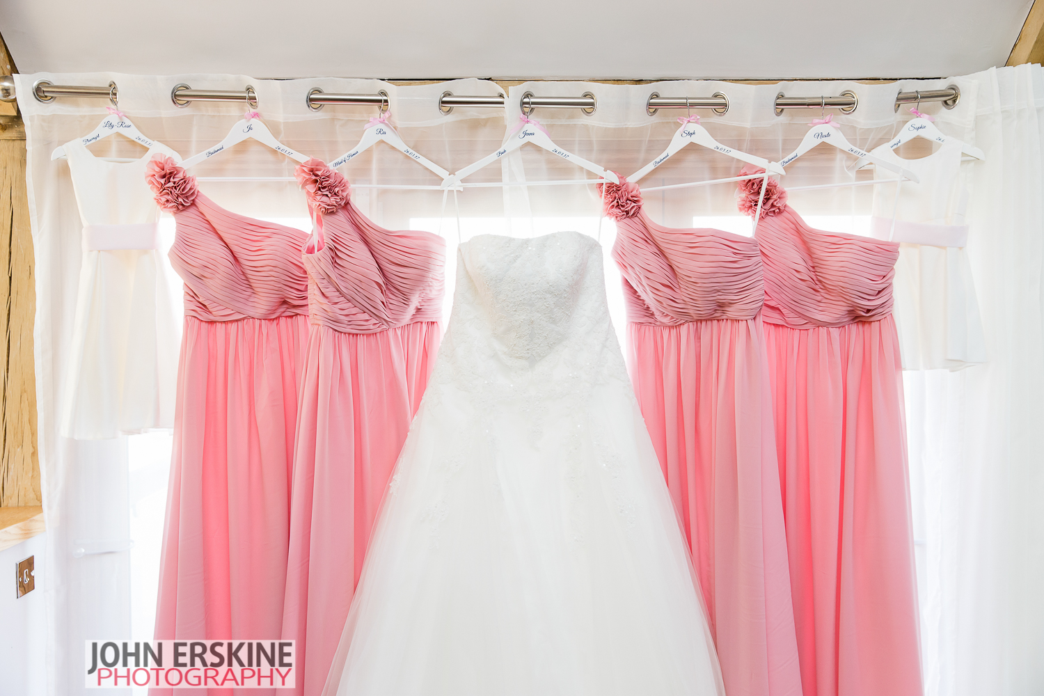 All The Girls Dresses Bridal Wedding Dress Hanging Up
