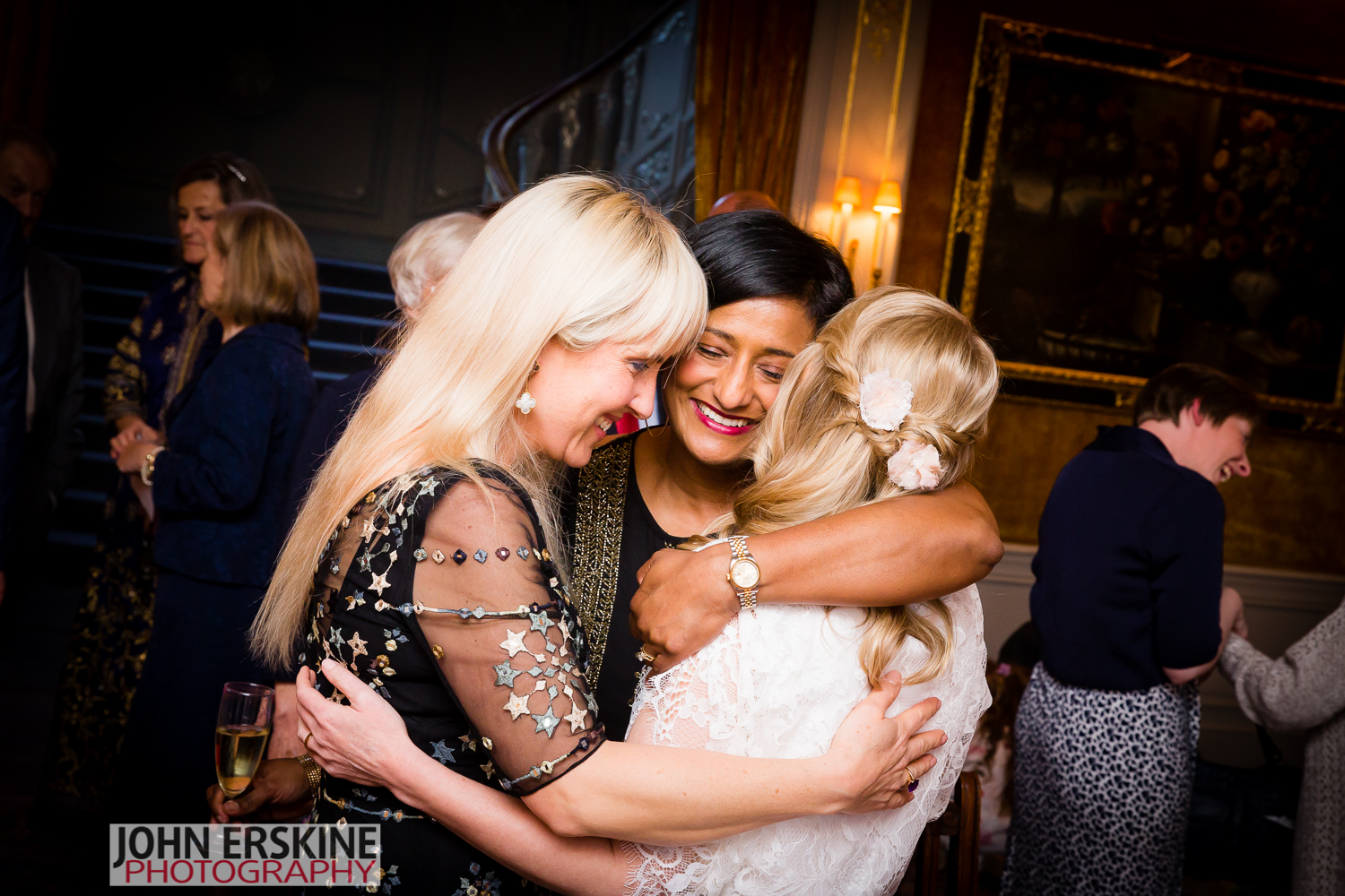 Brides Friends Hug Reportage Wedding Photographer Mayfair