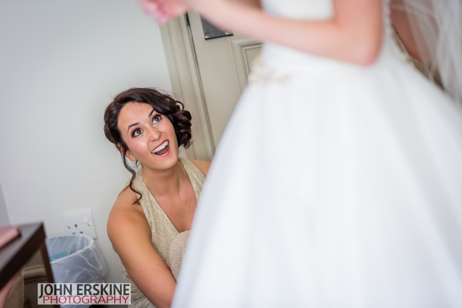 Checking the Bridal Gown Bridesmaid Laughing