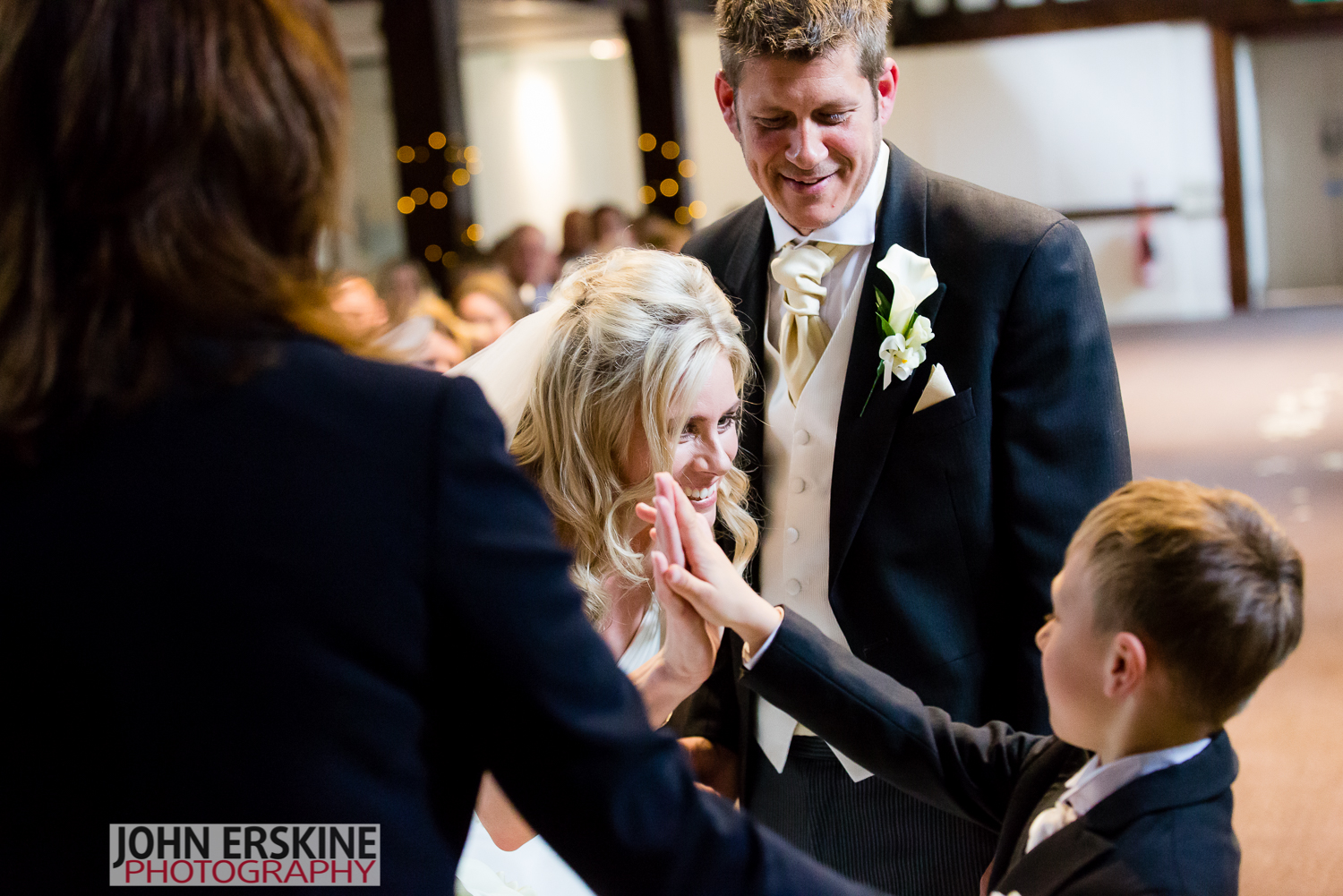 high five for ring bearer little boy