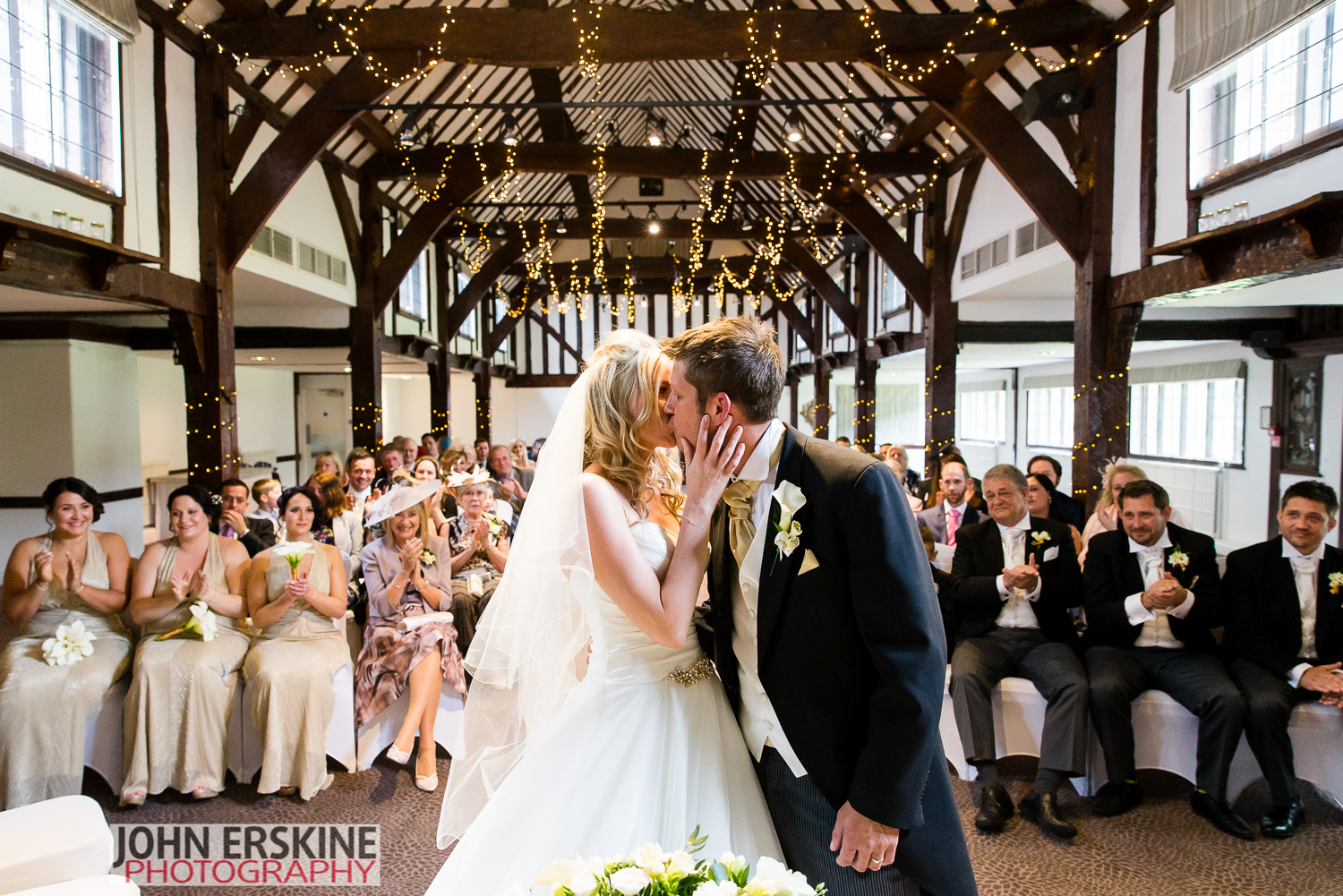 surrey wedding photographer first kiss mercure box hill