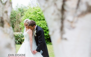 romantic shoulder kiss wedding portrait