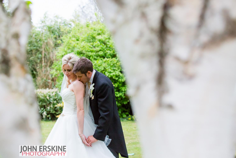 romantic shoulder kiss wedding portrait