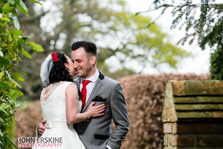 Bride Whispers Groom Portrait St Augustines Priory Wedding Photographer Bilsington